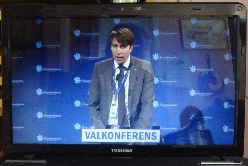 Richard Jomshof i talarstolen under Sverigedemokraternas valkonferens 2014